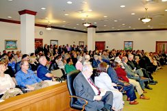 Koenig's swearing in attracts a crowd of well-wishers.