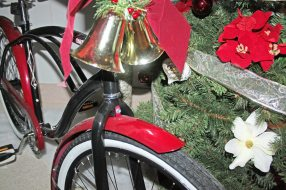 This tree comes with a full-size, adult bicycle that is brand new.
