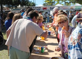 #Events: Key West's fishing history is celebrated - A group of people standing in front of a crowd - Fête