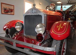 #News: Firehouse Museum preserves rich history - A red and black truck sitting on top of a car - Car