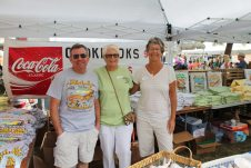 Volunteers Lydia Trimmer, Steve Graham and Denise Whichar hand out hundreds of T-shirts and smiles while supporting the Florida Keys Commercial Fishermen's Association.