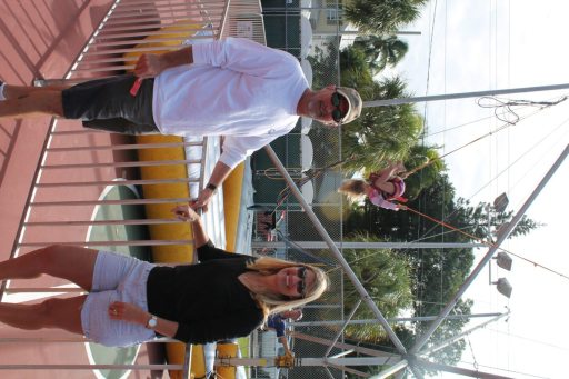Barry and Trish Gibson visit the kids' area while daughter, Taylor, shows off her bungee skills in the background.