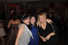 Mona Santiago hears her favorite song with Doria Goodrich and Annie Madruga.