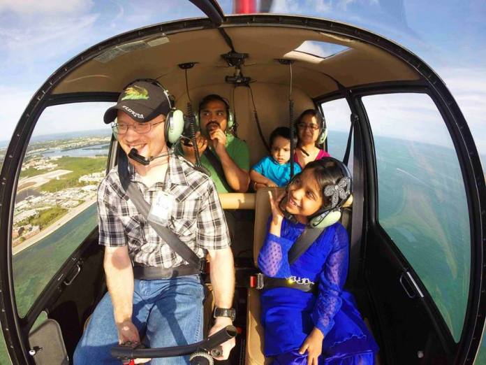 'Love is in the air' See Key West from a helicopter seat this Valentine's Day - A group of people in a car - Air Adventures Helicopters