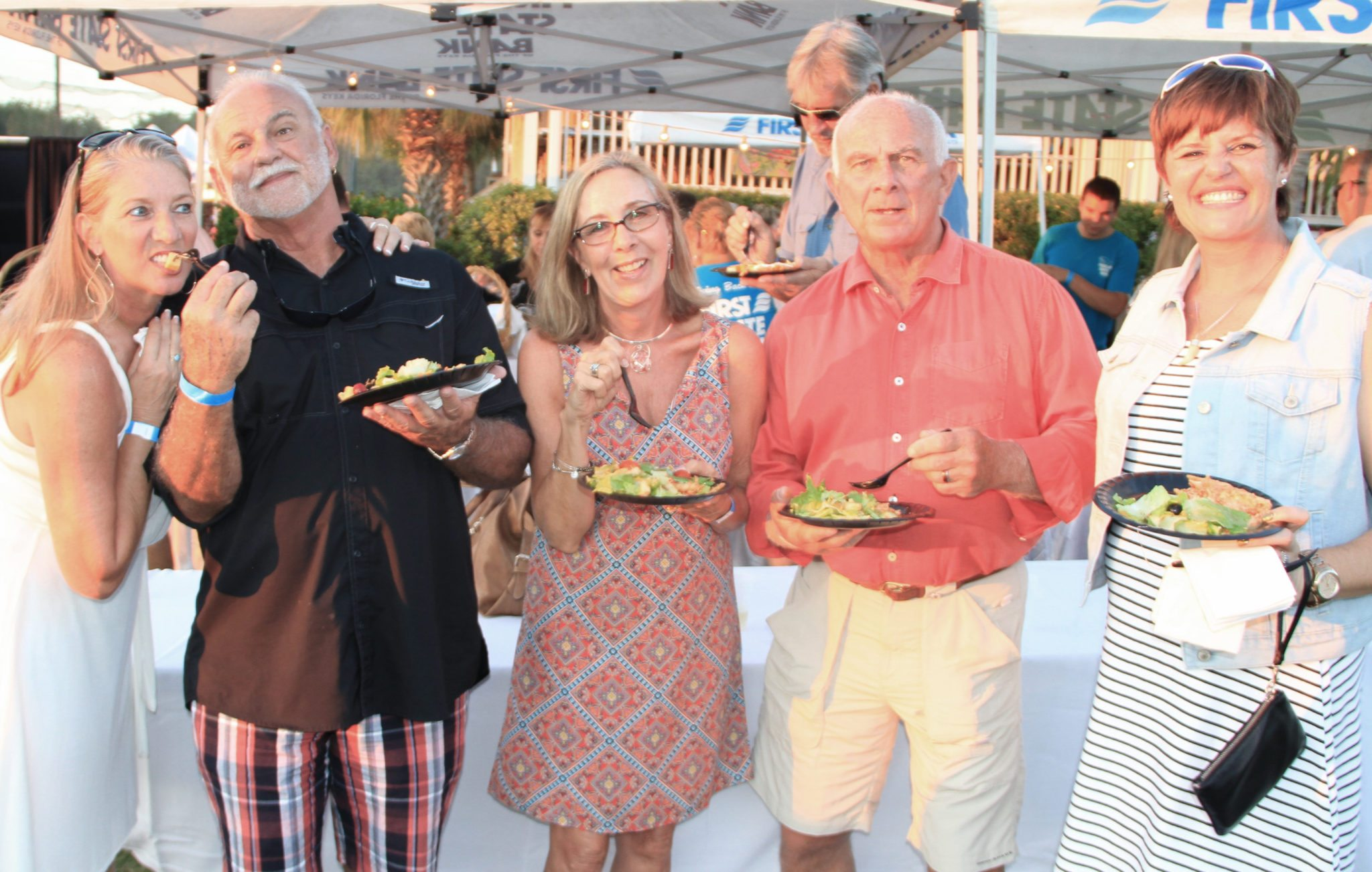 Jo Socha, County Commissioner Tony Yaniz, Christie and Patrick O'Connell and Becki Balcer snack on some of the goodies the golf course provided for the fund-raiser.