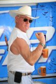 Art Stevens flexes his guns while filling a beer mug. That's practice, friends.