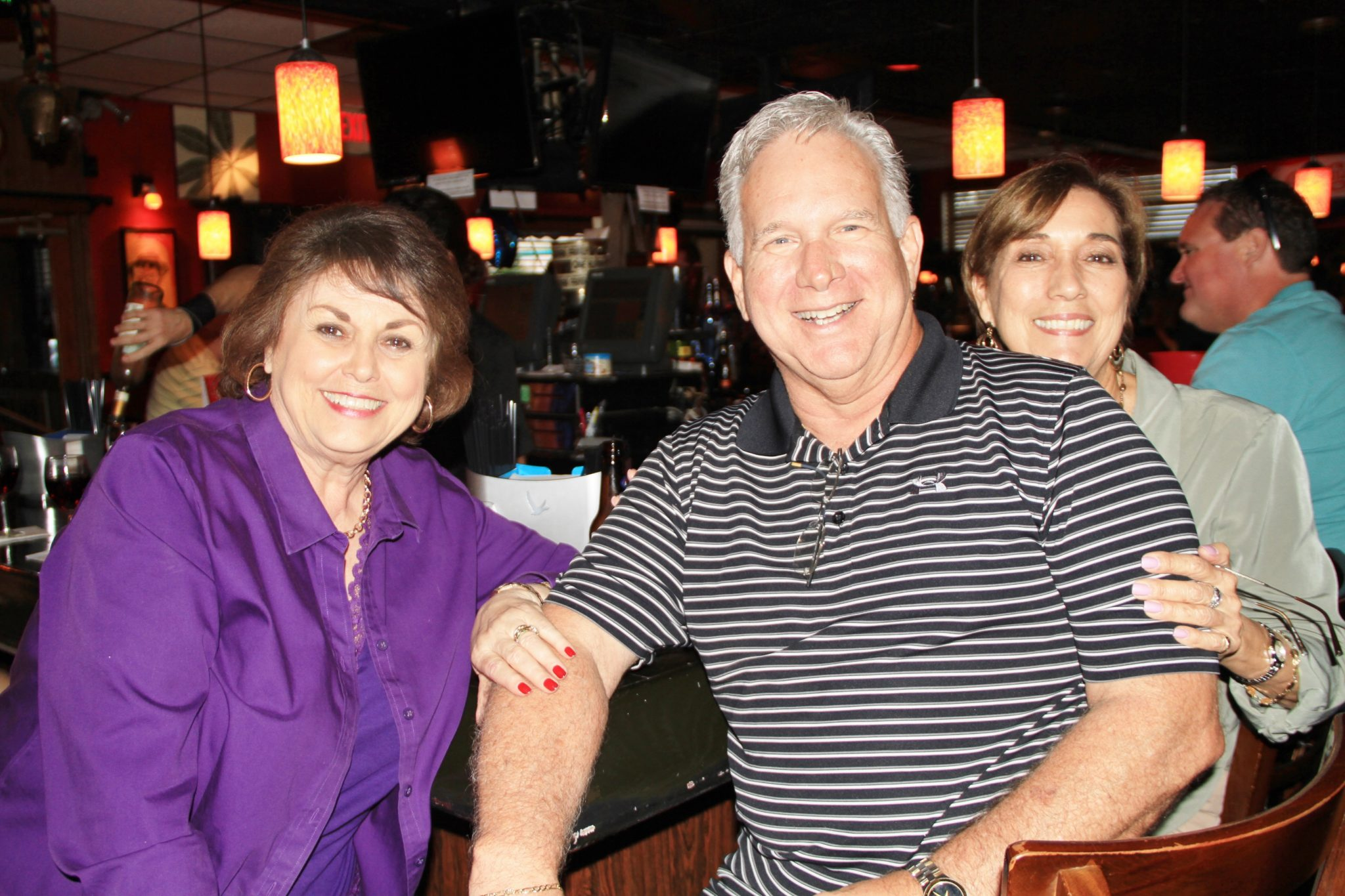 Sue and Sandra Barroso and Pat Labrada enjoy an evening out on the town.