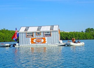 Tie-up take-out – Harbor Hillbillies open for business in Boot Key - A small boat in a body of water - Water transportation
