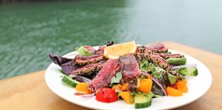 Hidden restaurant with noticeable flavor - A plate of food on a table - Geiger Key Marina