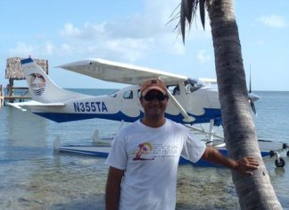 Pigeon Key's Kelly McKinnon to address his alma mater FKCC - A man standing next to a palm tree and water - Boat