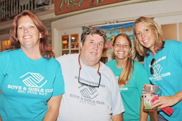 Boys and Girls Club Area Director Cece Williamson, left, Executive Director Dan Domdroski, Big Pine Key Program Director Lauren Waldrop, and Board Member Megan Bensted oversee the raffle.