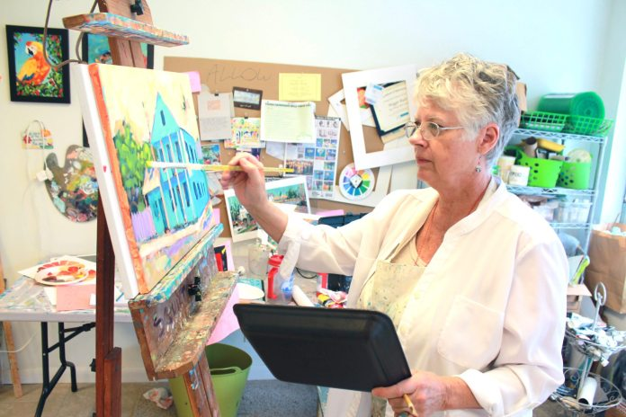 Maggie Ruley paints in tropical tones - A person standing in front of a laptop - Florida Keys
