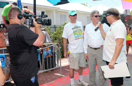 Magic Frank, left, and Key West City Manager Jim Scholl are being interviewed for KeyTV by Bill Hobee while Chris Davis films.