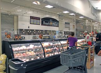 Marathon's Publix transforms into bigger, better store - A group of people standing in front of a store - Publix