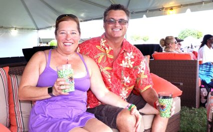 Kris Later and Steve Schluter test out the couches in the VIP area. More than 175 VIP tickets were sold for the event.