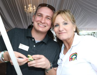 MARC Board Member Lee Ann Holroyd, with son Matthew Dalton, try the rock lobster and seafood tortellini prepared by Shor, the restaurant at the Hyatt.