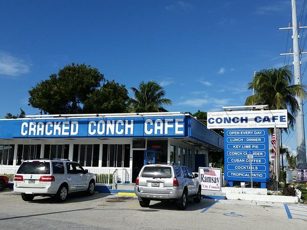 Cracked Conch is hub during big storms - A sign above a store in a parking lot - Cracked Conch Cafe