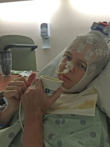 "Lori Longstreth is recovering from brain surgery in Miami, with a coffee and thumbs up. ""I just cut her hair,"" said her daughter, Morgan, with a giggle. ""Hopefully, she won't hate me."""