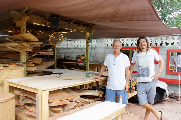 Handcrafted Skateboards are made in Key West - A man standing in a kitchen preparing food - Key West
