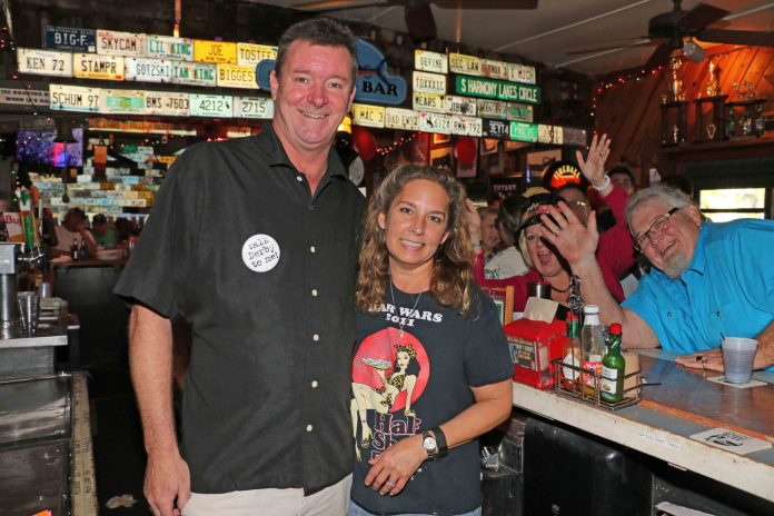 Staying Power: Half Shell's bartenders have been there for decades - A man standing in front of a store - Alcoholic Beverages