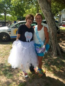 Sharon Hirsch, left , and Lorie Rouse act as Tooth Fairies to raise awareness and levity for the cause.