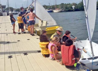 Smooth Sailing: Camp rears new sailors - A group of people on a boat - Sail