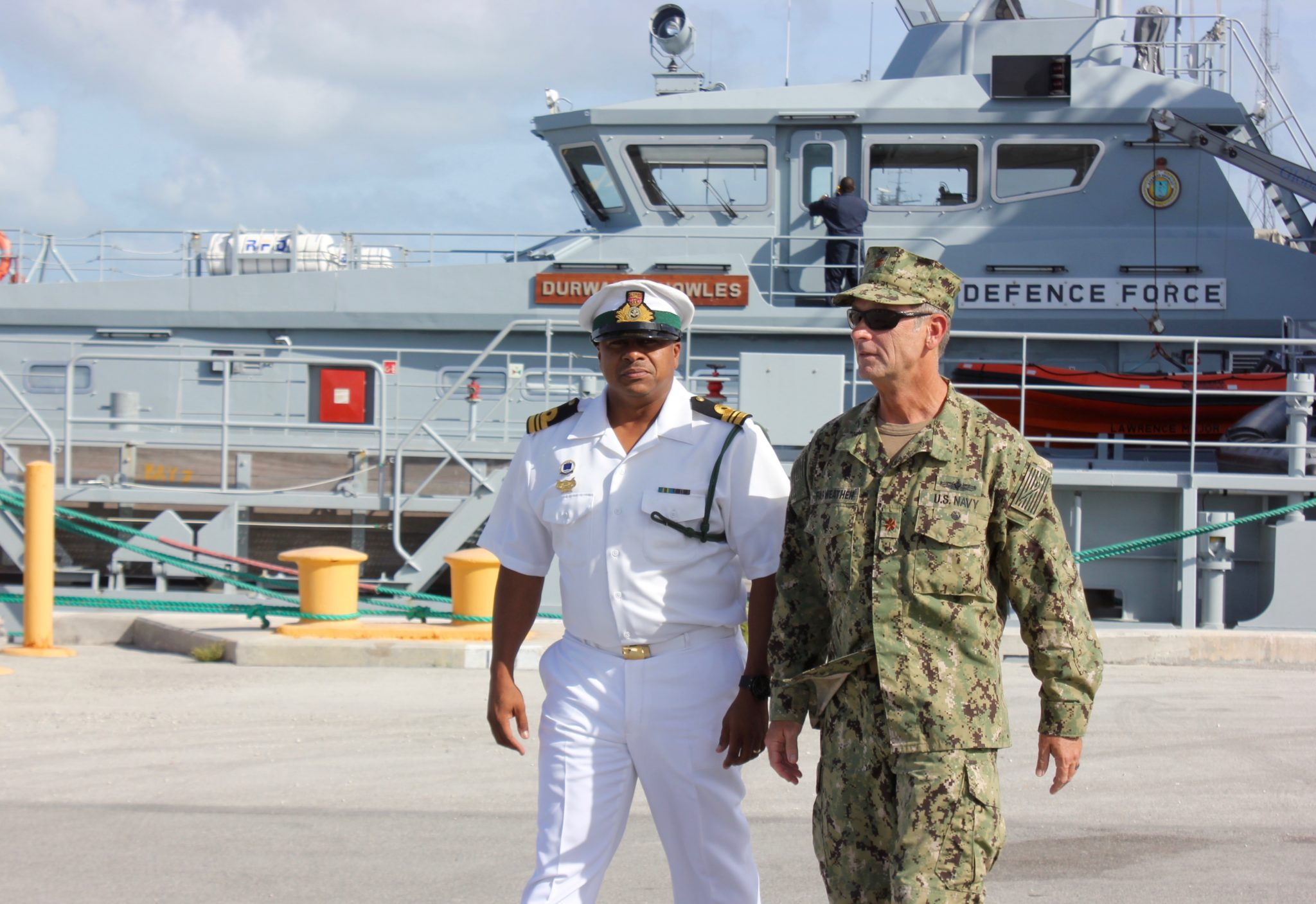 """Commander Bethel organizes efforts with Lt. Commander John """"Stormy"""" Fairweather, surface operations and acting XO"""