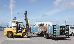 25,000 bottles of water being loaded onto nine Bahamian ships.