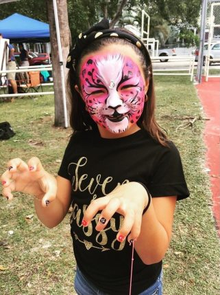 Natalie Gomez spends her seventh birthday at Children's Day – the face painting booth is her favorite!