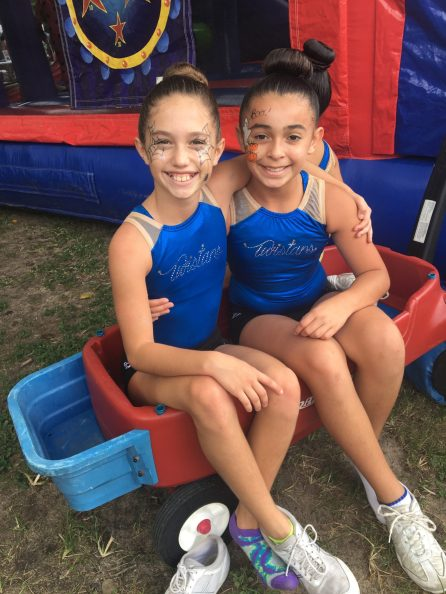 Maleah Fraga and Yasmin Lara of the Key West Sports Academy Twisters hangout before preforming.