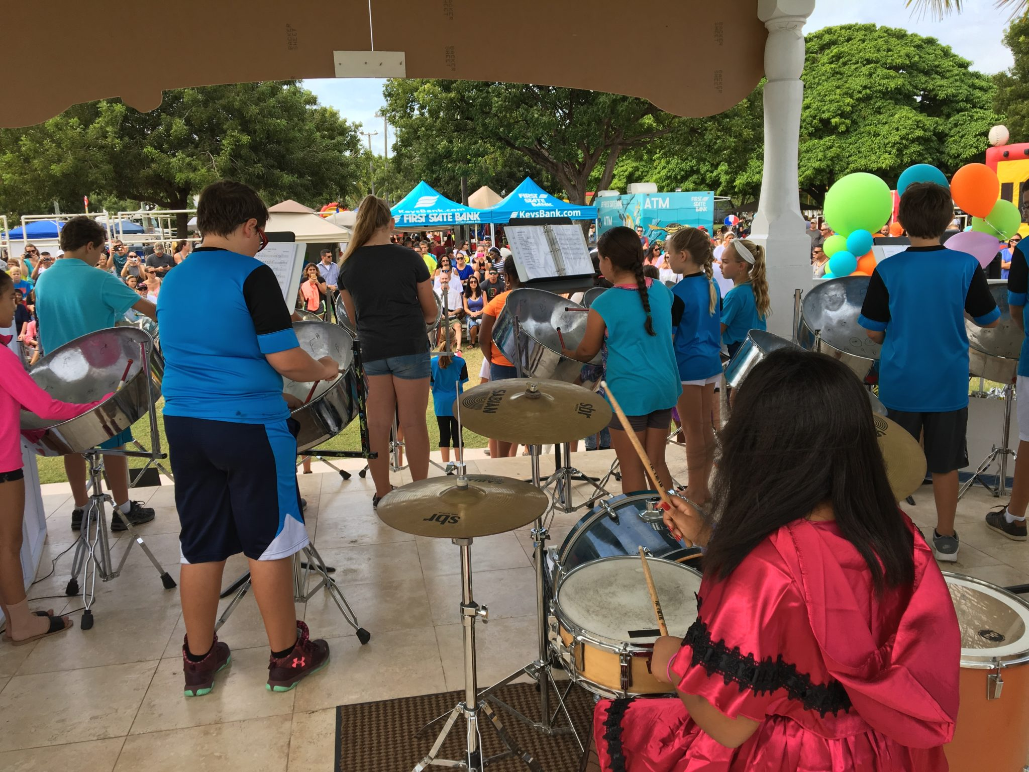 The Gerald Adams' Steel Your Heart Band plays 'Three Little Birds' on the steel pans.