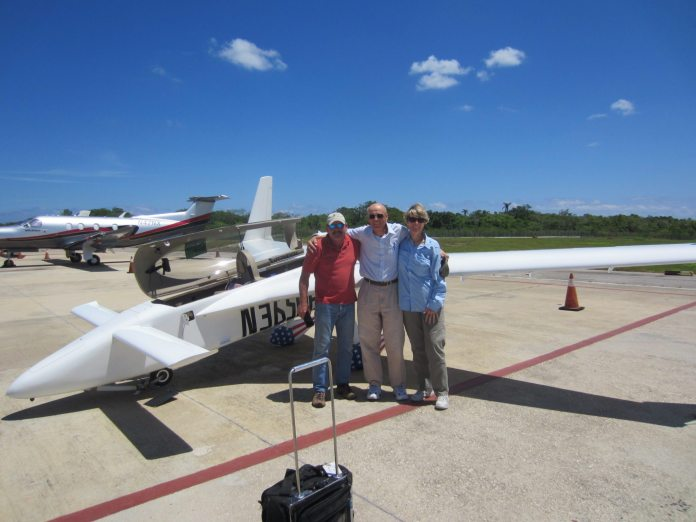OPEN SKIES TO CUBA - A group of people standing around a plane - Aviation