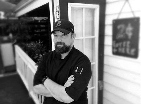 ReMARCable Surf & Turf Fundraiser - A man standing in front of a window - AIDS Help