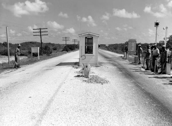 Overseas Toll 1938-1954 - A street scene with focus on the side of a road - Overseas Highway
