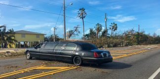CURFEW IN EFFECT – EMERGENCY PERSONEL ENTERING KEYS - A car parked on the side of a road - Luxury vehicle