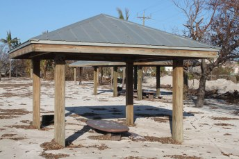The sand buried the picnic tables at Sombrero Beach.