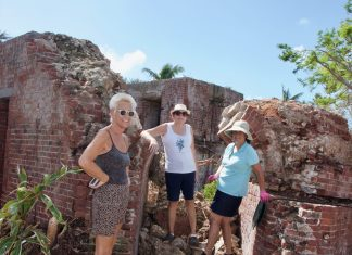 West Martello Looks Ahead after Damage - A group of people standing on a rock - West Martello Tower