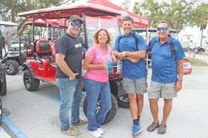 Let's Go Carts has a premium spot at the entrance to the event. Pictured are three generations of the MacClugage family —Mitch, left, mom and dad Sandy and Rick, and grandfather Rich.