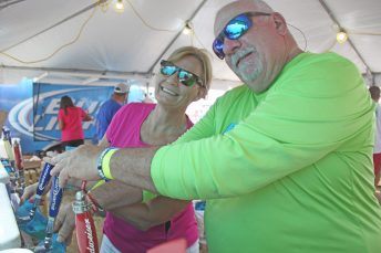 """Bambi Kuck and """"Spook"""" Roussin work the taps in the beer tent."""