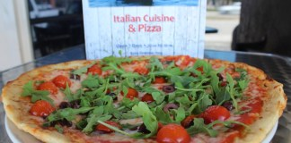 Pizza with pizzazz – Triton Seafood Restaurant adds new menu - A pizza sitting on top of a table - California-style pizza