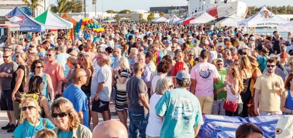 Taste of Key West - A group of people standing in front of a crowd - AIDS Help