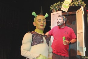 Director Devin Clarke gives Aiden Judd (Shrek) some stage direction.