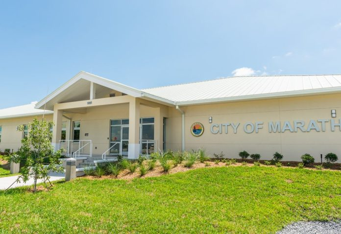 REORGANIZATION AT MARATHON CITY HALL - A large lawn in front of a house - Florida Keys