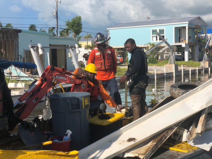Canal cleanup begins in all areas - A group of people standing on a boat - Key West