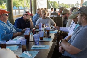 25 Disabled Veterans Are Honored - A group of people sitting at a table - Islamorada