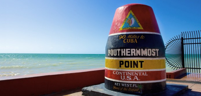 AN AMAZING 'SLIDE SHOW' - A bottle of water on a beach with Southernmost point buoy in the background - Southernmost Point of the Continental US