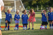 Assistant coach Alex Burton, 9, checks on Upper Keys American Youth Soccer Organization Region 864 6U team member Kamila Hein, 4, at center, during practice at Founders Park in Islamorada Friday evening, September 28, 2018. Photo by Doug Finger Photography