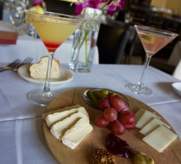 The Happiest of Hours: Martin's is a Key West Favorite - A plate of food with a glass of wine - Martin's