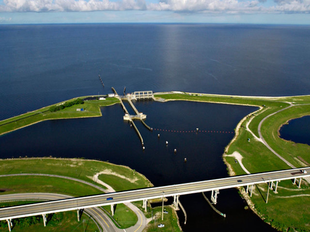 $1.6 Billion Okeechobee Reservoir Takes Huge Step Forward - A small boat in a body of water - Lake Okeechobee