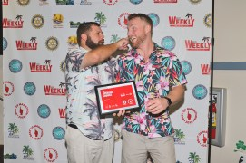 Cheddar, left, and Jordan joke around in front of the step and repeat. In addition to Cheddar's win for Best Bartender, the Overseas Lounge also took home awards for Best Late Night Spot and Best Bar.